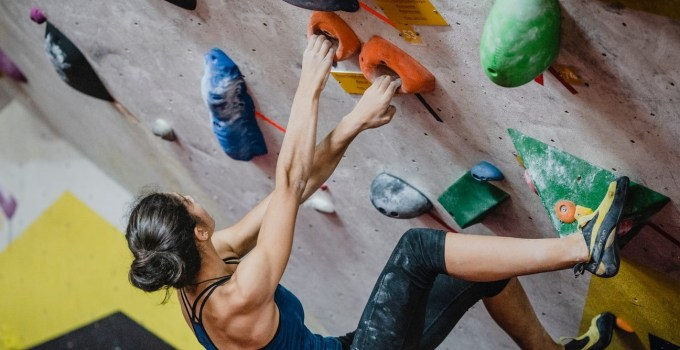 Lead climbing means being the first up the rock, trailing the rope, which is held by a belayer on the ground