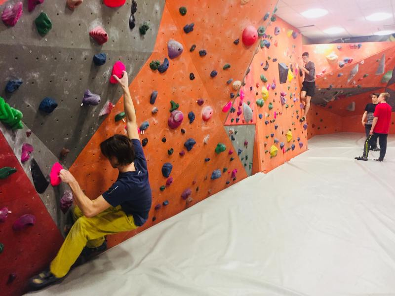 Marcin is testing new climbing wall grips fluo pink
