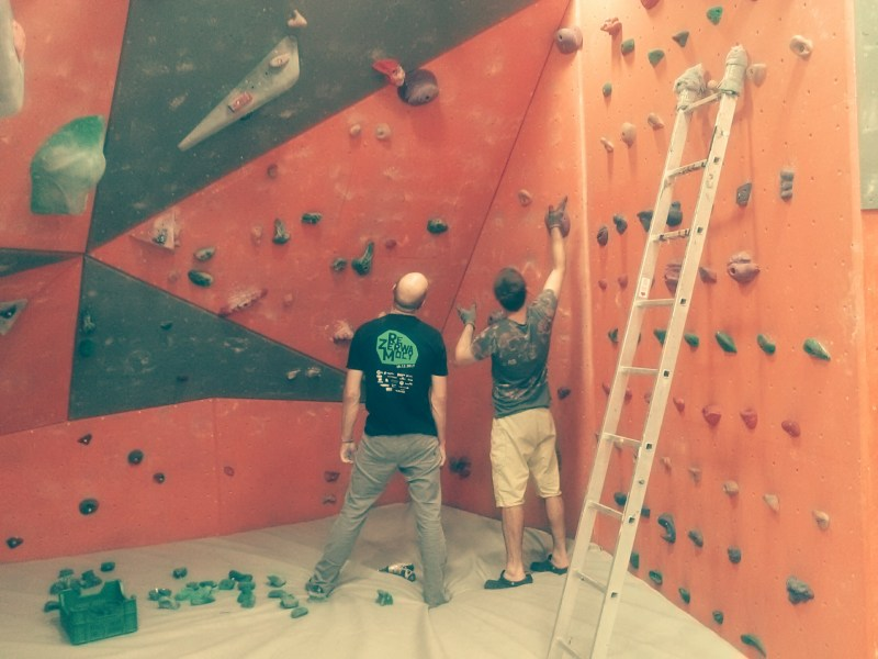 Routesetters testing new climbing holds