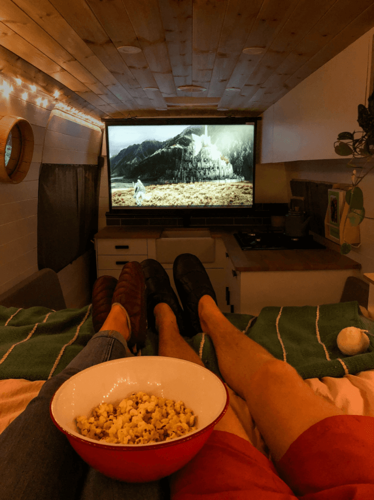 campervan van life projector setup couple watching lords of the rings with popcorn in a campervan viewsonic m1+ projector