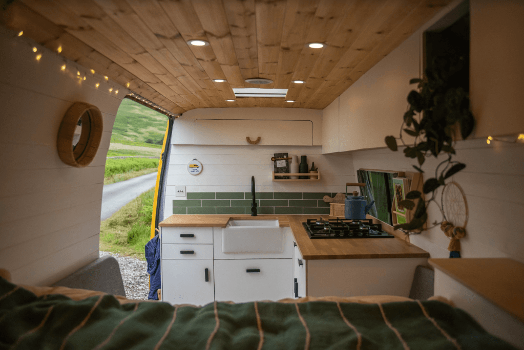 a self built campervan kitchen units with belfast sink