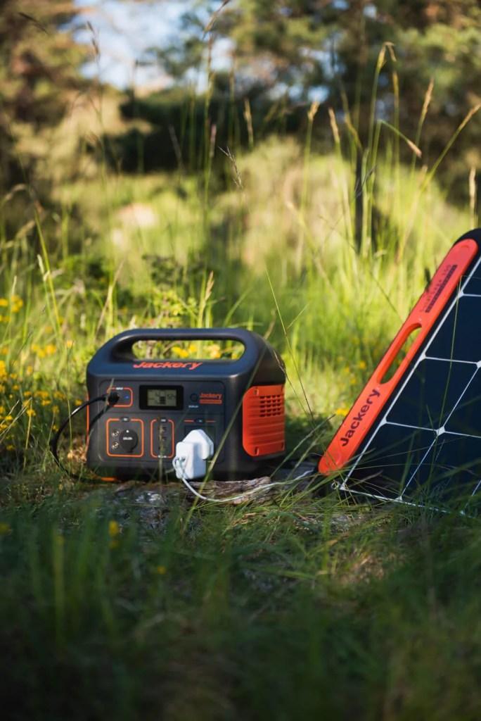 jackery explorer 500 portable power bank and jackery solar saga 100w solar panels in an off grid setup van life digital nomad
