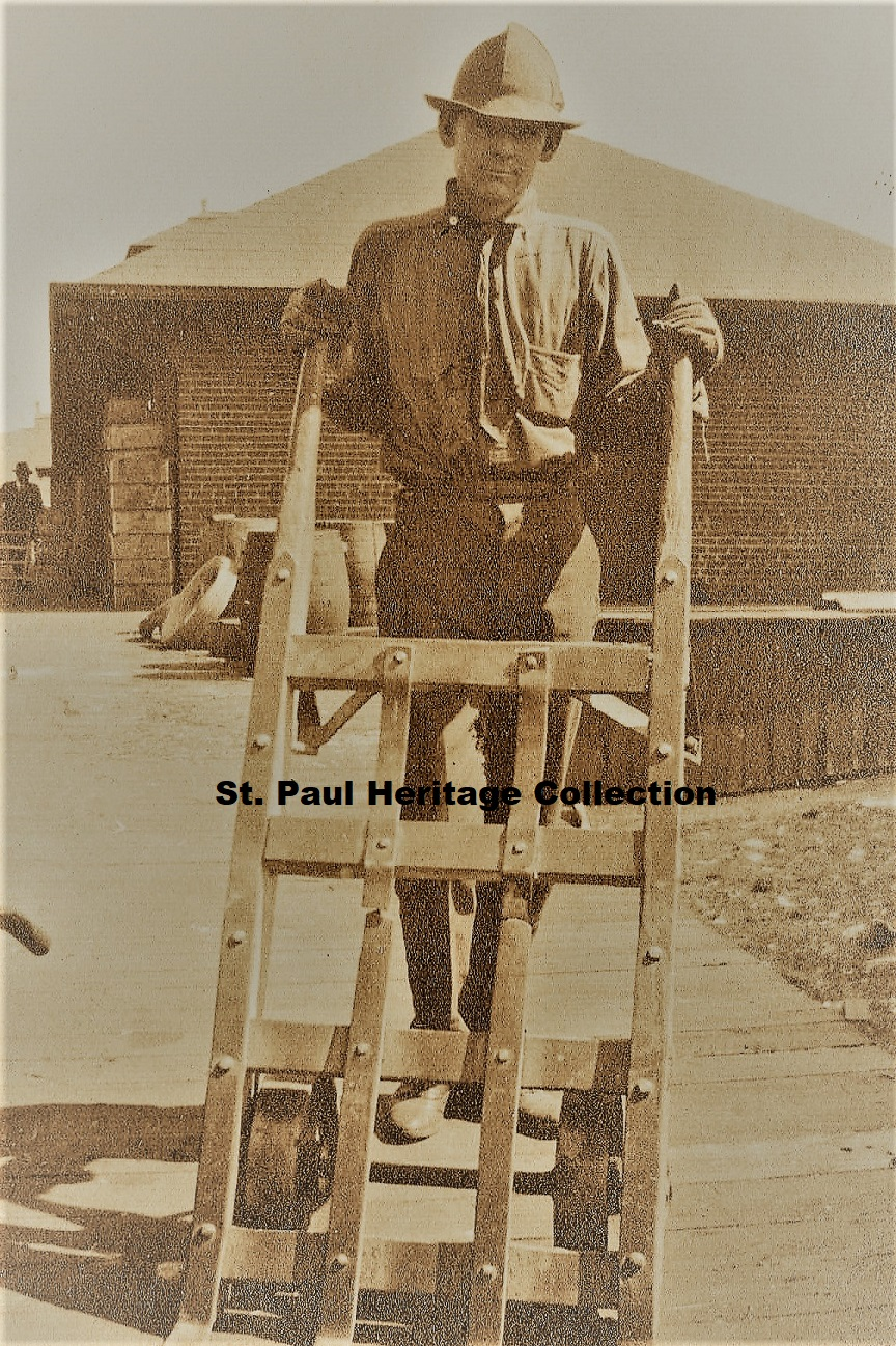 Man at depot with hand truck