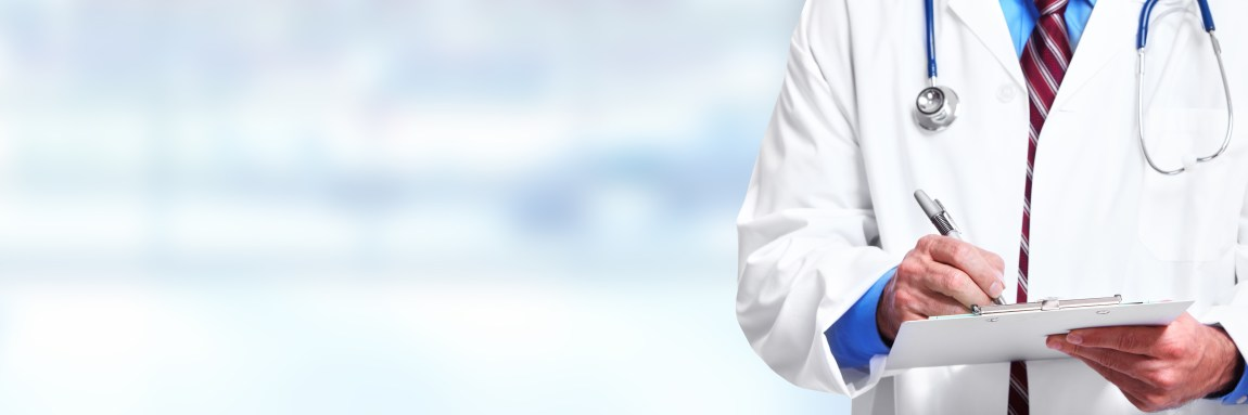 Hands of medical doctor writing prescription over blue background