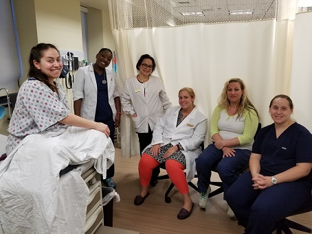 Five female learners posing with Gynecologic Teaching Associate