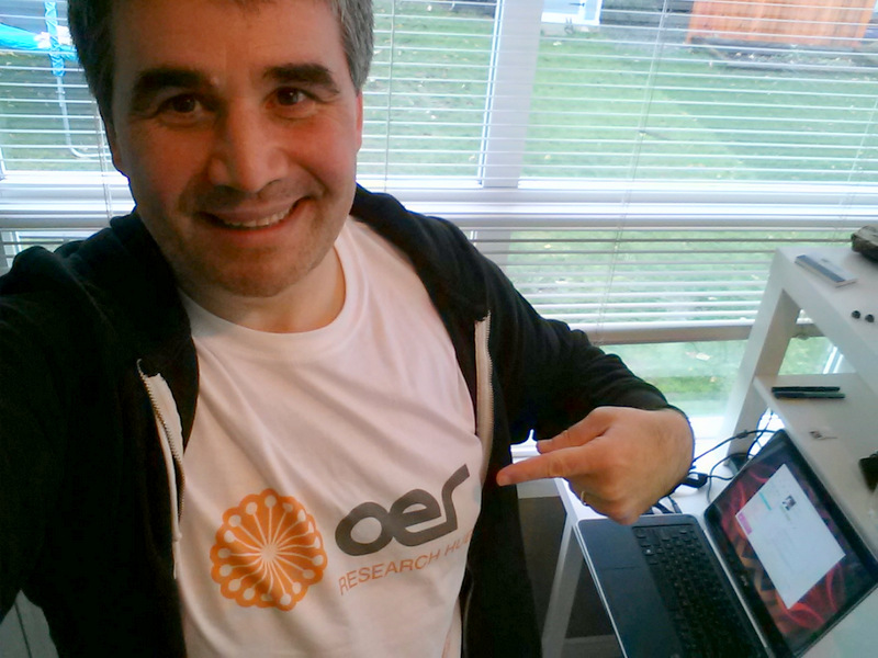 Proudly sporting my shiny new OER Research Hub t-shirt.