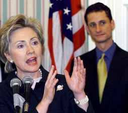 Democratic Senate candidate for New York Hillary Clinton speaks at a campaign stop in 2000, while then Brooklyn Congressman Anthony Weiner looks on. (Credit: Reuters)