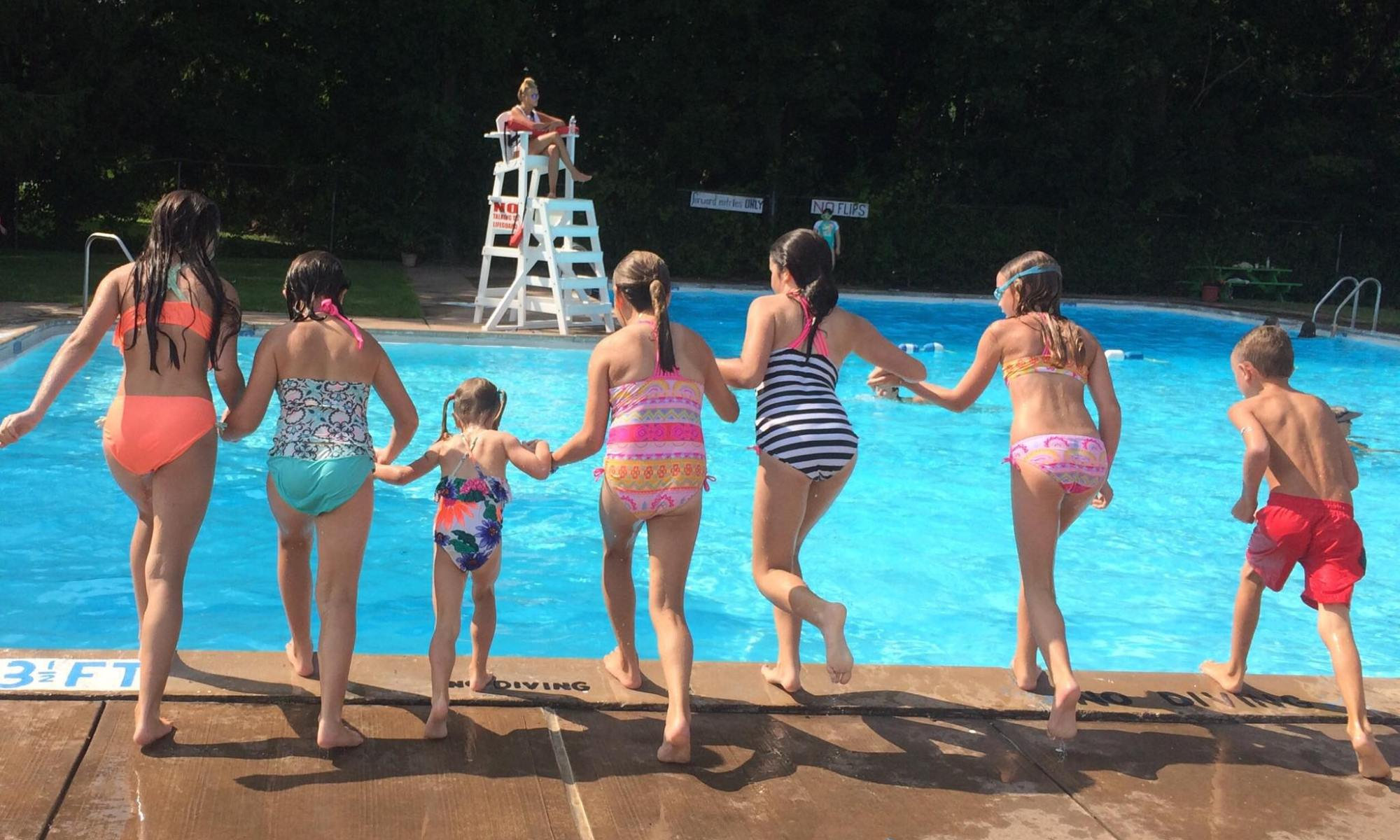 kids about to jump into the pool