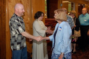 Pastor LuAnn and Pat greeting