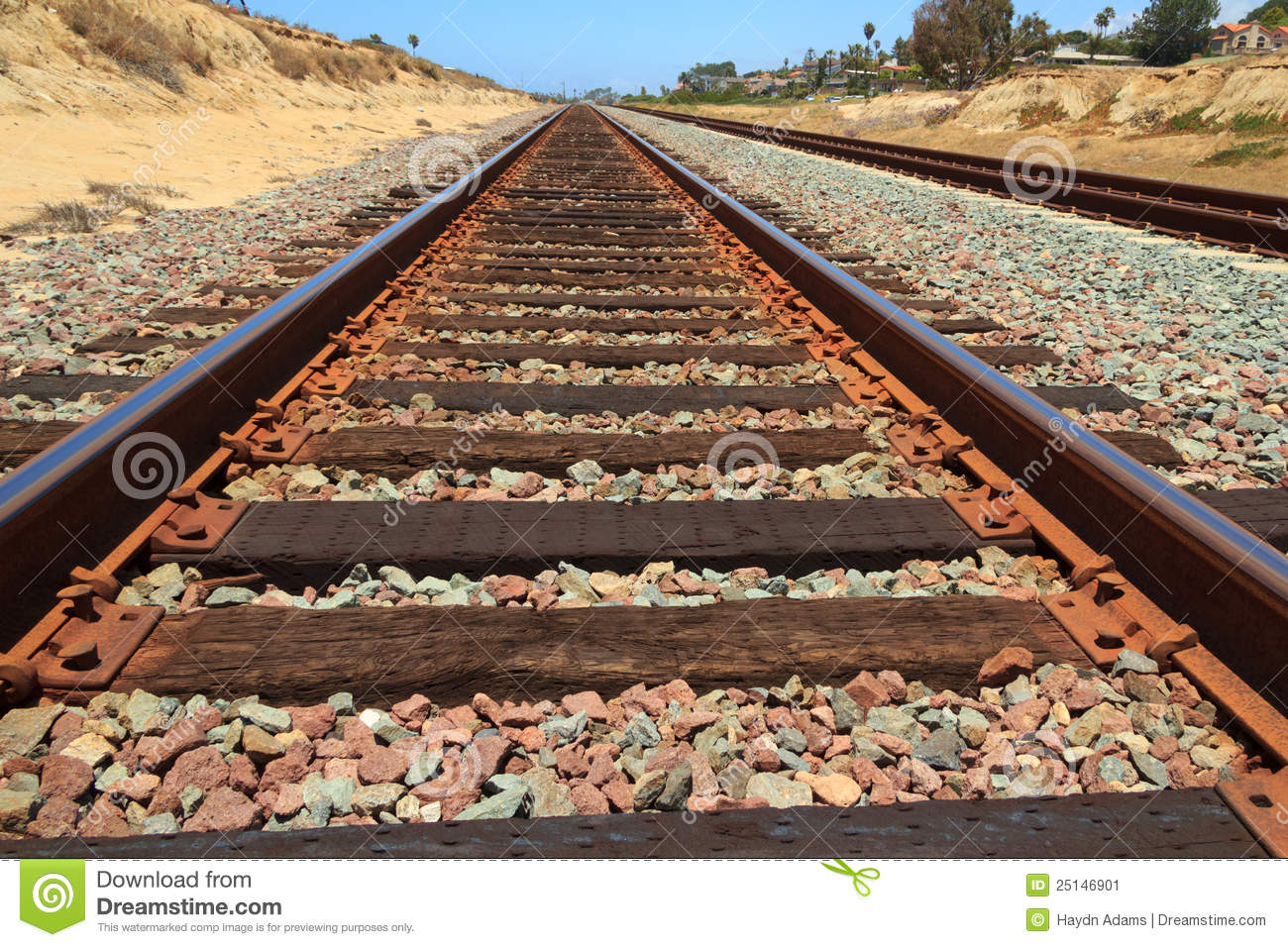 hight resolution of rusty train tracks with sandstone stock image