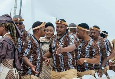 Zulu Men In Traditional Leopard Skin Shirts With Head