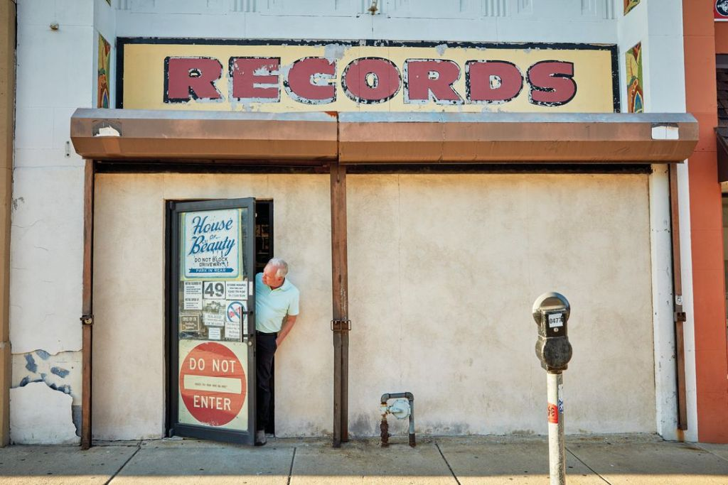 """Val Shively at his shop, in Philadelphia, home to more than four million 45s. His customers know what they want. """"You can't come in here and just look around,"""" he says. (Jason Varney)"""