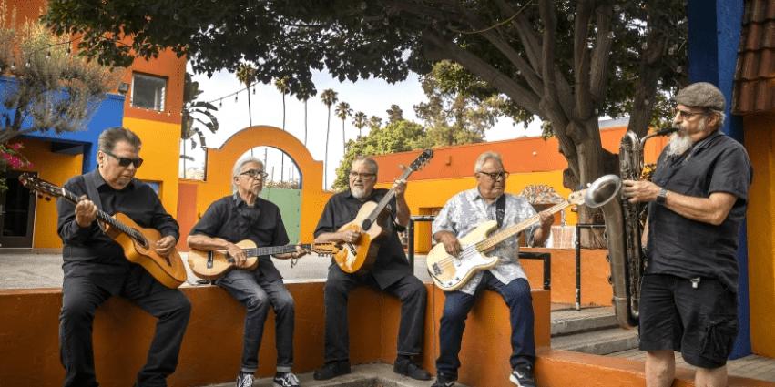 Los Lobos, from left, is Cesar Rosas, Louie Pérez, David Hidalgo, Conrad Lozano and Steve Berlin.(Allen J. Schaben / Los Angeles Times)