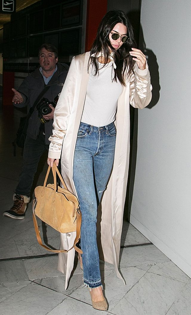 On Jenner: August Getty coat; Balmain duffel; Givenchy pumps; Re/Done Elsa High Rise Jeans ($298).