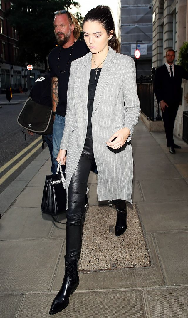 On Jenner: Saint Laurent Classic Small Sac De Jour Bag ($2,890); Balenciaga leggings; Saint Laurent Boots