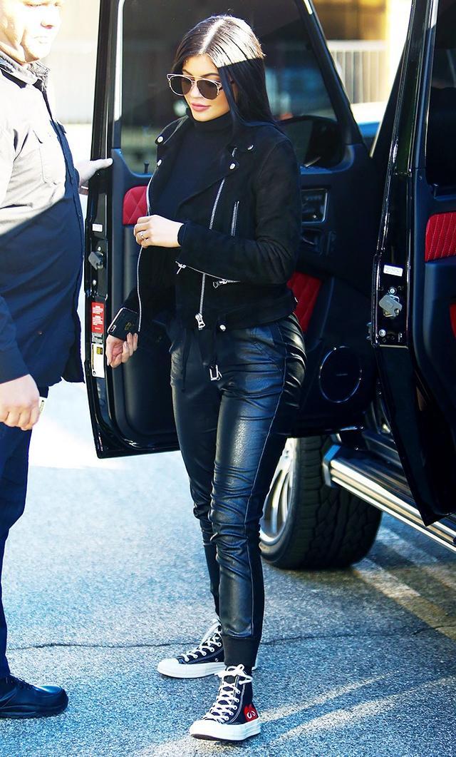 On Jenner:Dior Technos Sunglasses($540); Acne Studios Leather Biker Jacket($1600); Comme des Garçons PlayChuck Taylor 1970s High-Top Sneakers($120).