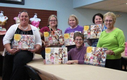 The November 'Gratitude Girl' Class with their Completed Girl Art Canvases - Wonderful Artwork, Ladies! (Photo taken by Riley)