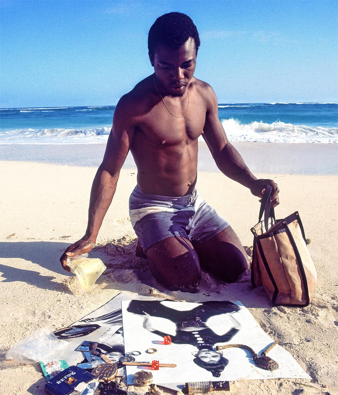 HQ-man-on-beach-with-Photos.jpg