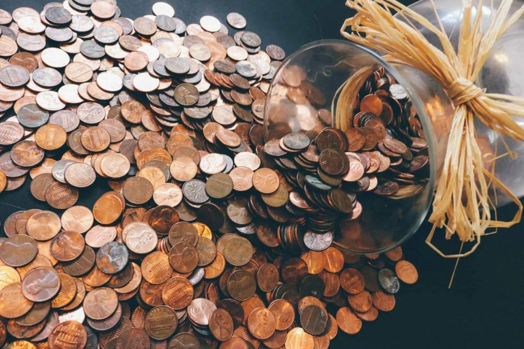 Copper coins spilling from vase