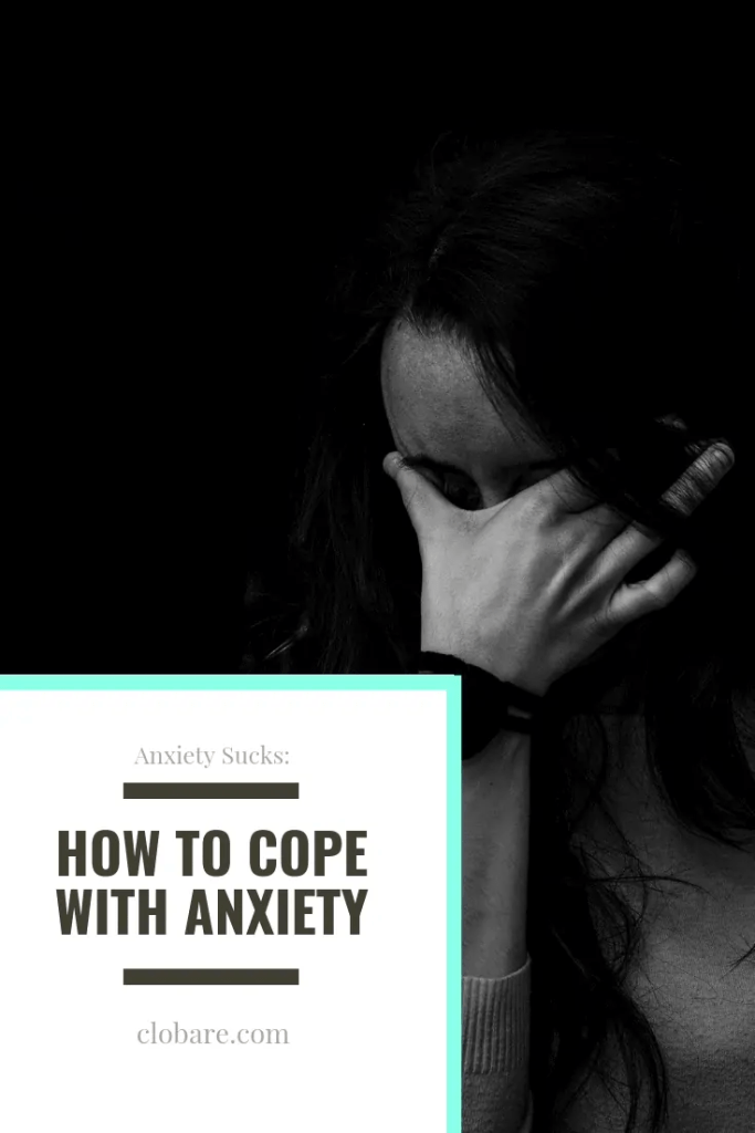 Clo Bare holding her forehead as she deals with anxiety. Anxiety sucks, but in this post she talks about how to cope.