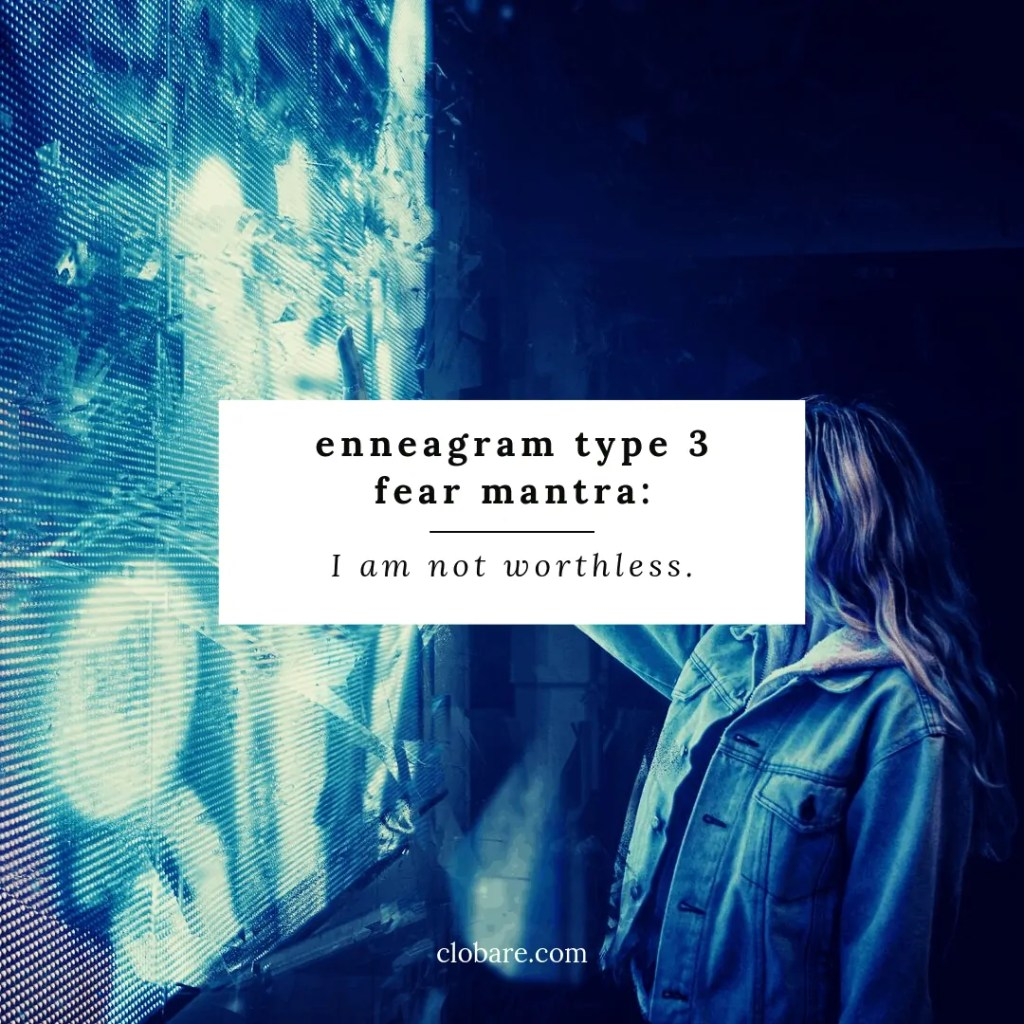 woman looking at neon blue light thinking enneagram type 3 fear mantra: I am not worthless.