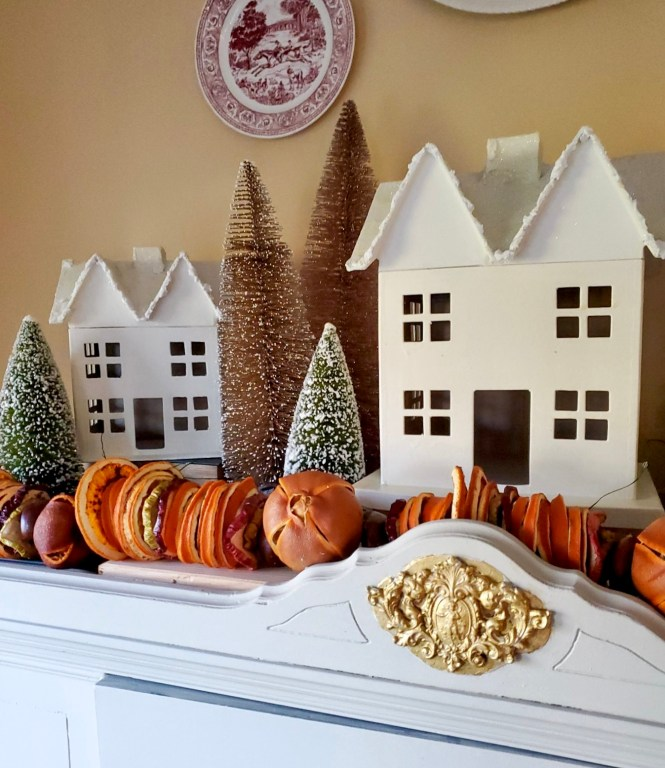 Dried fruit garland with houses and bottle brush trees