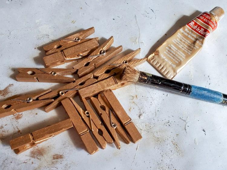 clothespins, stencil brush and Rub N Buff