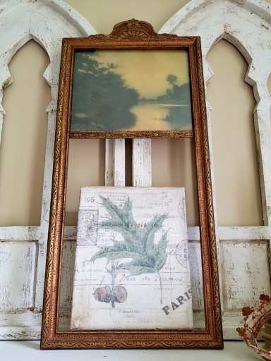 Vintage acorn transfer finished and  sitting on a shelf inside a frame