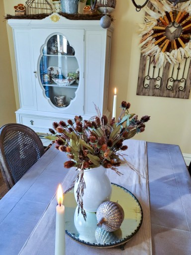 Kitchen table.  showing the outside of the kitchen hutch and fall decor