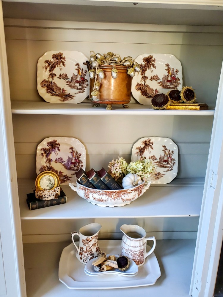 close up of the inside of the hutch showing natural fall decor