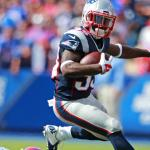 (09/20/2015 Orchard Park, NY) New England Patriots running back Dion Lewis leaps over Buffalo Bills defensive end Jerry Hughes in the second quarter at Ralph Wilson Stadium on Sunday, September 20, 2015. Staff Photo by Matt West.