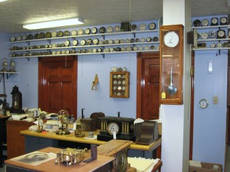 View of front work area, showing part of my Westclox collection. Note the Hermle precision regulator on the pillar.