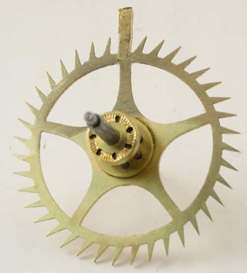 Plug inserted in the escape wheel
