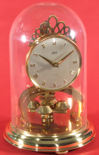 Schatz miniature 400 day clock dated 5 56 (May 1956) on the movement. The dome is plastic with two locking pins.