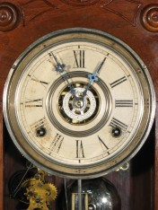 Original dial and hands. The disc in the center is for setting the alarm.