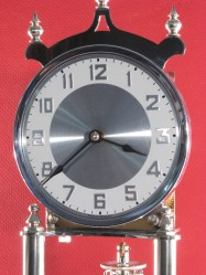 Dial with numerals on white painted chapter ring. Nickel plated bezel.