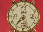 Dial with cream color background and flower decorations