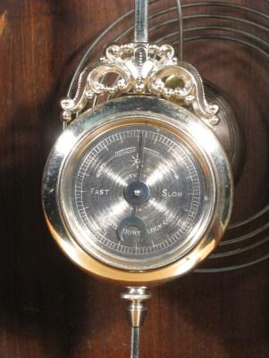 Closeup of pendulum. PATENTED DEC. 11TH 1883 WATERBURY CLOCK CO