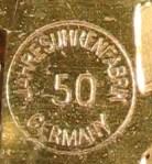 "Rear plate of movement says ""Jahresuhrenfabrik Germany 50"" in a circle"