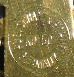 "Rear plate of the movement says ""Aug. Schatz & Sohne Germany KU 50"" in a circle"