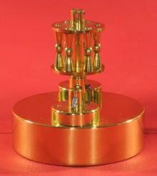 Pendulum 69.5 mm diameter, 10.4 ounces, iron core with brass cover spun over it.
