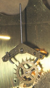 The escape wheel (center) and anchor with adjustable pallets (right),