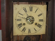 """The painted wood dial has a similar stye to the Seth Thomas dials of the same period. Note the large 5 minute dots. The location of the """"6"""" and its dot is off by 1 minute!"""