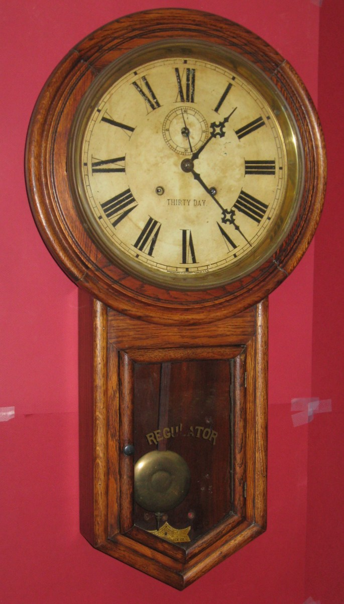 Waterbury Admiral 30 Day Round Drop Oak Cased Wall Clock