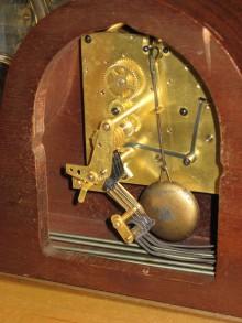 Movement in case showing pendulum bob.