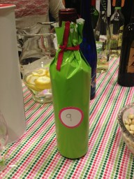 Lime green wrapping paper plus 2inch round label and ribbon= wine bottle blind
