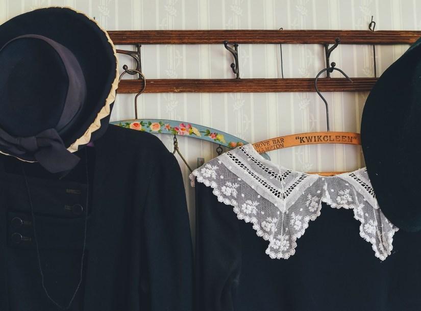 Black Vintage Clothing Hanging on Hooks