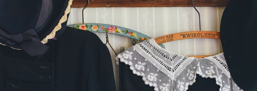 Black Vintage Clothing Hanging on Hooks