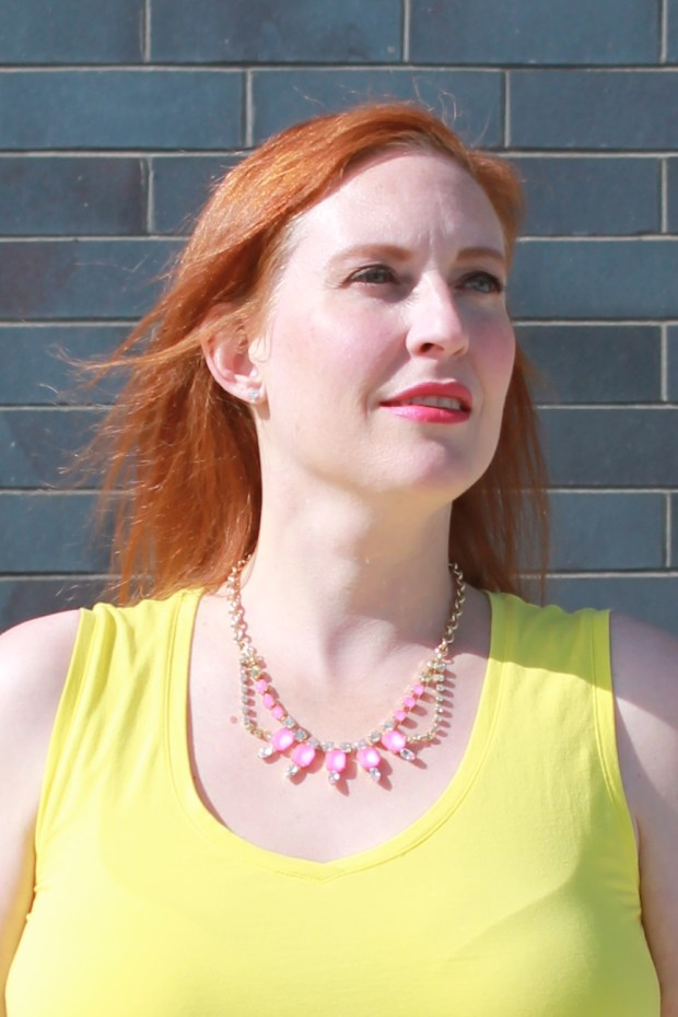 yellow top pink necklace