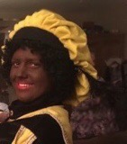 naturist in black face dressed as Black Pete Christmas icon in Dutch culture